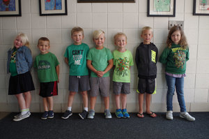 Kindergarten students learn color identification...