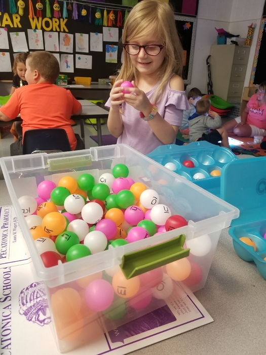 Mrs. Laue's class is working letter names and sounds in the kindergarten ball pit.